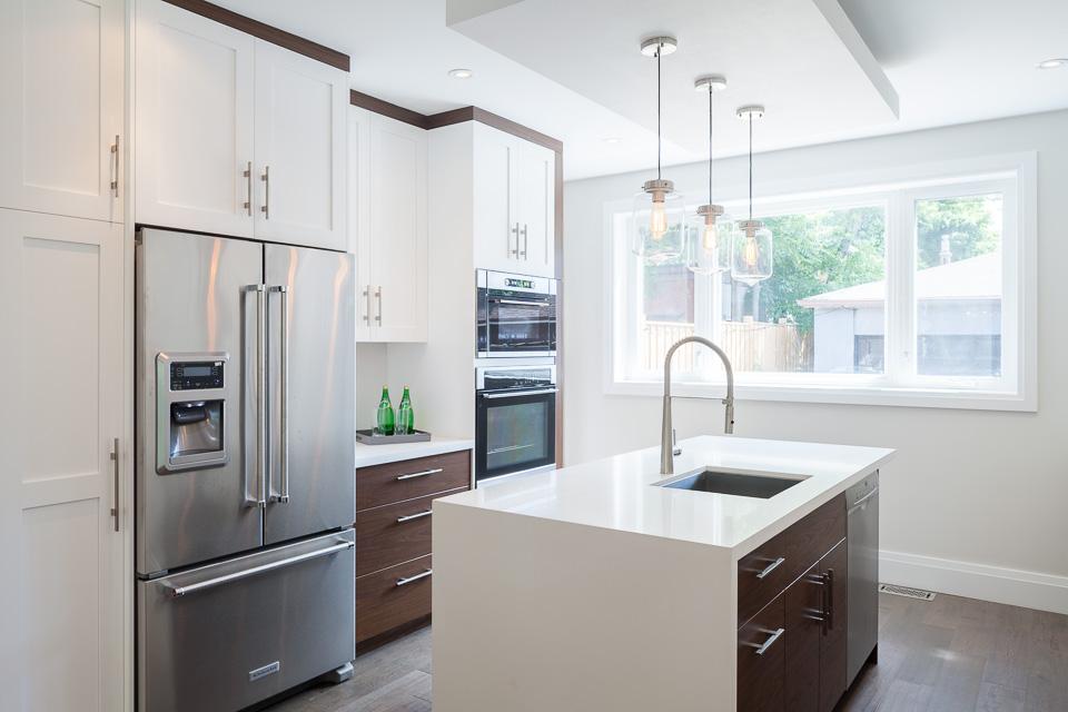 Cabinets: MDF Shaker, White Laquer U0026 Polymer Slab, Walnut (Horizontal  Grain) Countertop: White Quartz Hardware: Brushed Nickel Bar Pulls